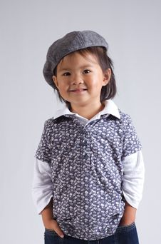 Free Little Asian Girl With A Hat Stock Image - 6366621