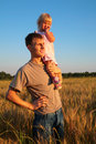Free Father Hold Daughter On Shoulder On Wheaten Field Stock Photos - 6374123