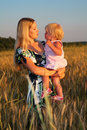 Free Mother Holds Child On Hands In Wheaten Field Stock Image - 6374191