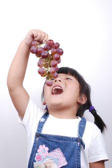 Free Girl Eating Grape Stock Photo - 6370110