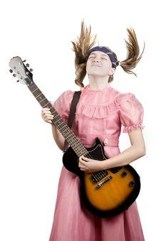 Free Young Girl With A Rock GuitarPlaying Headbanger Mu Royalty Free Stock Photo - 6371355