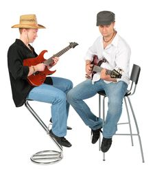 Two Sitting Men In Hats  Play On Guitars Stock Image