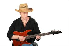 Free Young Man In Hat Play On Guitar Royalty Free Stock Image - 6372056
