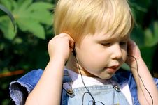 Free Child Listens To Music Stock Photo - 6372180
