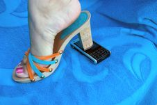 Free Cellphone Under A Female Foot In High Heels Royalty Free Stock Images - 6372899