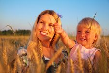 Mother With Child Sit In Wheaten Field With Cornf Stock Photography