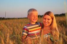 Free Mother And Son  Sit On Wheaten Field Royalty Free Stock Images - 6374589