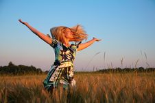 Free Girl With Lifted Hands And Flying Hair On Wheaten Royalty Free Stock Image - 6374676