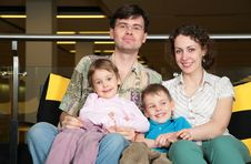 Free Family Sit On Sofa In Dark Hall Royalty Free Stock Photography - 6374777