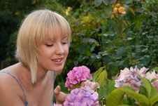 Free Young Blond Girl Smelling Flower Royalty Free Stock Image - 6374786