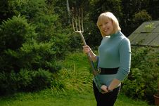 Free Blond Lady Gardener With Fork Royalty Free Stock Photos - 6374838