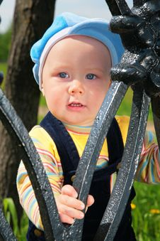 Free Child From Metal Fence Stock Image - 6375521
