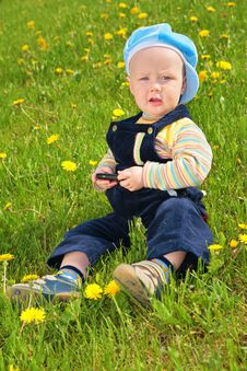 Free Child Sits On Grass Royalty Free Stock Images - 6375609