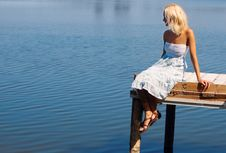 Girl Sitting On A Pier At The River Bank Stock Photos