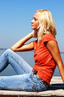 Free Cute Girl Sitting On A River Bank Royalty Free Stock Photography - 6377957