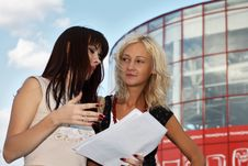 Free Two Young Women Having A Discussion Royalty Free Stock Image - 6377976