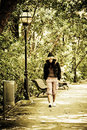 Free Young Woman Walking In The Park Stock Images - 6382494