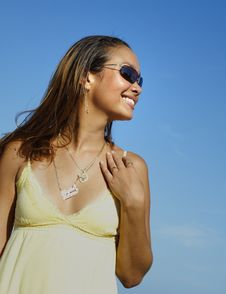 Beautiful Woman On A Blue Sky Royalty Free Stock Photography