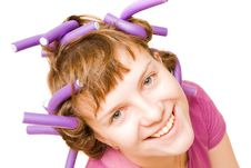 Young Pretty Girl With Hair Curlers Stock Images