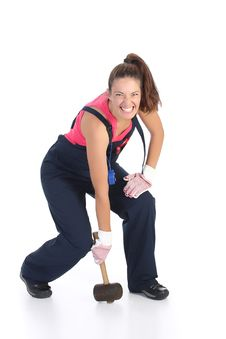 Woman With Black Rubber Mallet Royalty Free Stock Photography