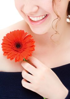 Free Young Smiling Woman With A Red Flower Royalty Free Stock Images - 6390639