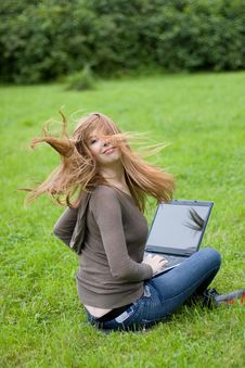 Young Girl Sitting On The Grass. Royalty Free Stock Images