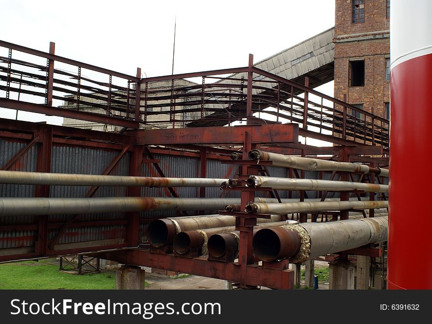 Stack of old steel pipes at pipe-bridge