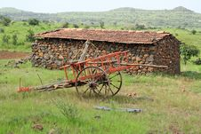 Rural Stone Hut And Painted Cart Royalty Free Stock Images