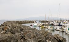 Rock Seawall Around Harbor Stock Image