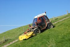 Tractor Mowing A Dike Stock Image