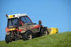 Tractor Mowing A Dike Royalty Free Stock Image