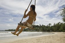 Free Girl On Swing On The Beach Stock Image - 6400771