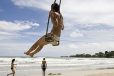 Free Girl On Swing On The Beach Royalty Free Stock Photos - 6400778