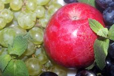 Green And Red Grapes And Apple Stock Photo