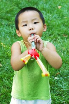 Free Baby Playing On Lawn Royalty Free Stock Image - 6402626