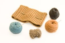 Free Knitted Garment And Skeins Of Yarn Stock Photo - 6405160