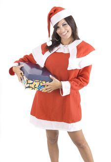 Pretty Claus Woman At Christmas Holding A Gift Box Royalty Free Stock Photos