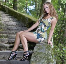 Woman Posing On Old Steps Royalty Free Stock Photography