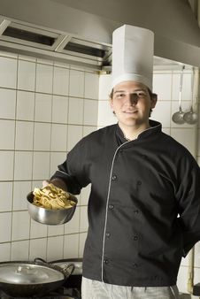 Free Chef Holding Noodles Royalty Free Stock Photography - 6409247