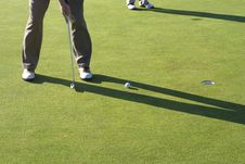 Free Man Putting Ball Into Hole Stock Images - 6409344