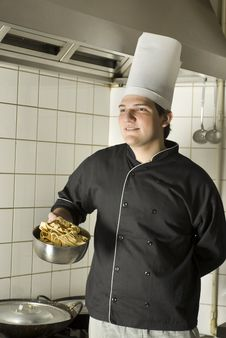 Free Chef Holding Noodles Stock Photo - 6409430