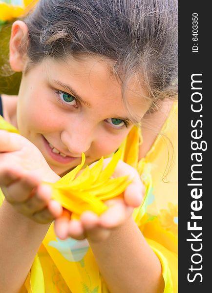 Beauty teen girl with sunflower petal