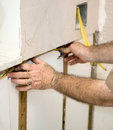 Free Electrician Wiring The Walls Stock Image - 6417291
