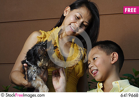 Free Mother Child And A Puppy Royalty Free Stock Photos - 6419668