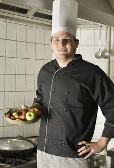 Free Chef Holding Fruit Stock Photography - 6413172
