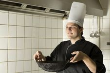 Free Chef Holding A Wok Royalty Free Stock Photography - 6413257