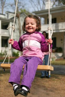 Little Girl Swinging On Rope Swing Royalty Free Stock Photos
