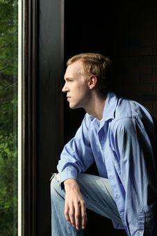 Natural Light Man At Window Royalty Free Stock Photography