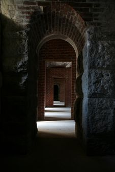 Looking Down A Brick And Stone Hallway Royalty Free Stock Photography