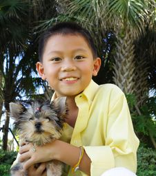 Free Boy Holding His Puppy Royalty Free Stock Photography - 6419707